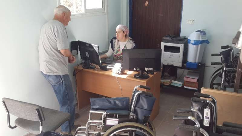 Leah Palmer assists a client with an equipment loan in Yeruham, a town in the Southern periphery.
